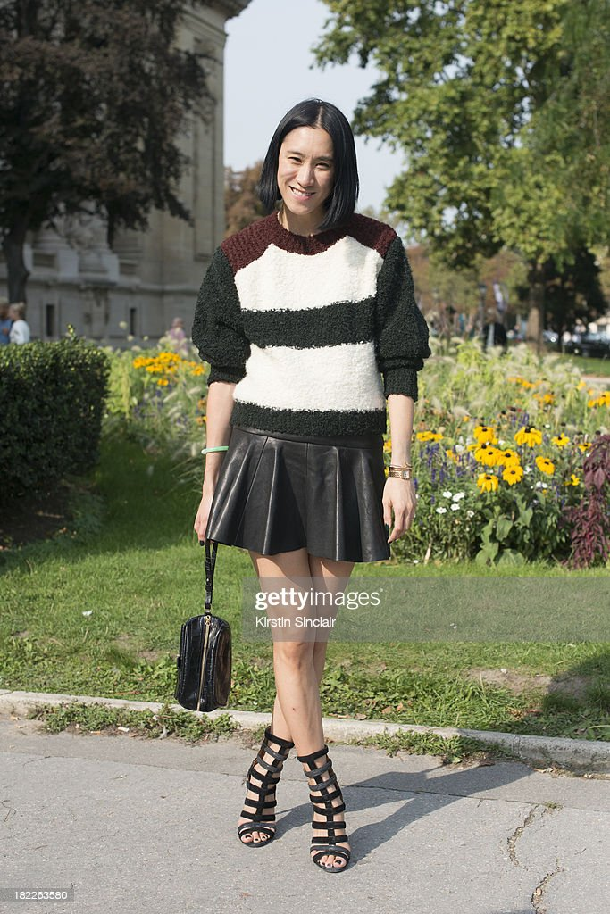 Fashion Editor of Lucky magazine Eva Chan wears an Isabel Marrant jumper, Thakoon skirt, Alaia shoes and a Whistles bag on day 5 of Paris Fashion Week Spring/Summer 2014, Paris September 28, 2013 in Paris, France.