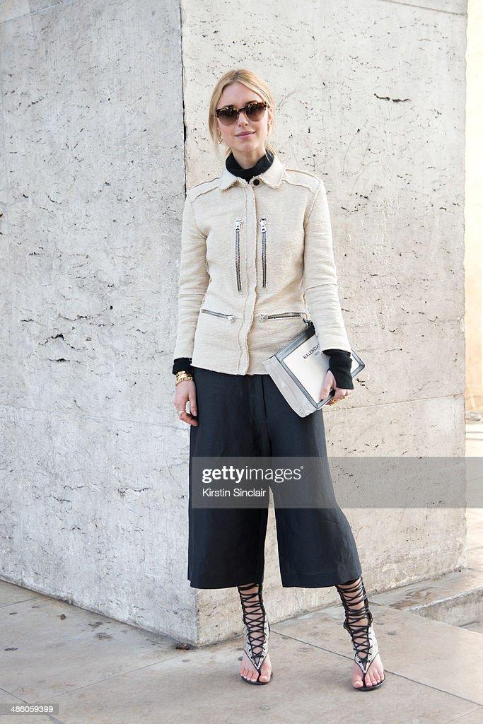 Fashion Editor Pernille Teisbaek wears a Balenciaga bag Acne coat and trousers Stella McCartney sunglasses and Malene Birger shoes on day 5 of Paris...