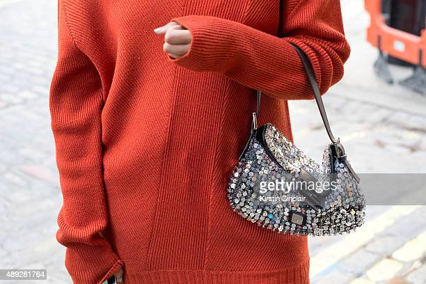 Fashion Editor Preetma Singh wears a Tome top and Fendi bag on day 2 during London Fashion Week Spring/Summer 2016/17 on September 19 2015 in London...