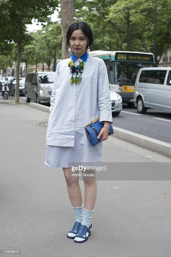 Fashion Editor Sherry Shen wears Marni shoes, necklace and bag, Cos shirt dress on day 3 of Paris Collections: Men on June 28, 2013 in Paris, France.