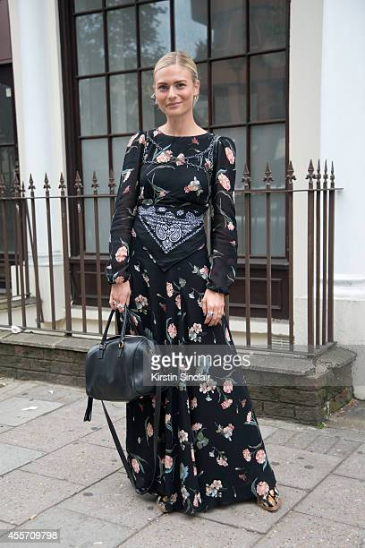 Fashion Features Editor Wardrobe Mistress at The Sunday Times Pandora Sykes is wearing a Reformation dress Free People shoes and Yves Saint Laurent...