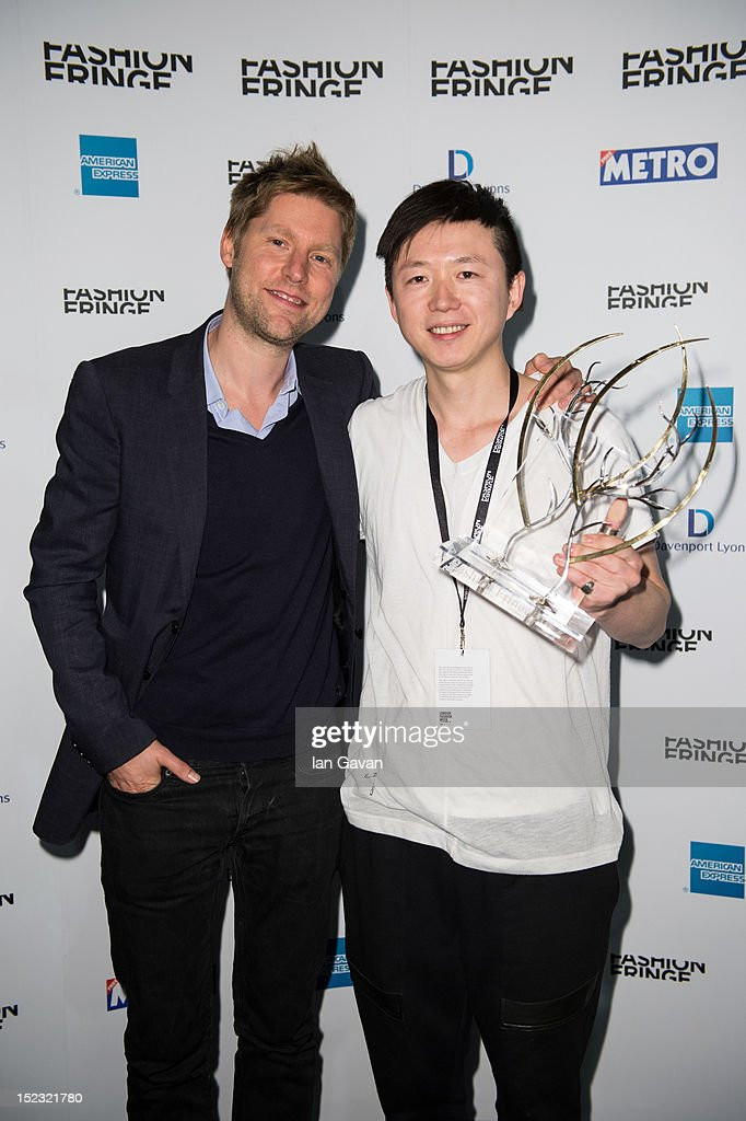 Fashion Fringe Chair Christopher Bailey poses with founder Colin McDowell and 2012 Fashion Fringe winner Haizhen Wang at the Fashion Fringe Final...
