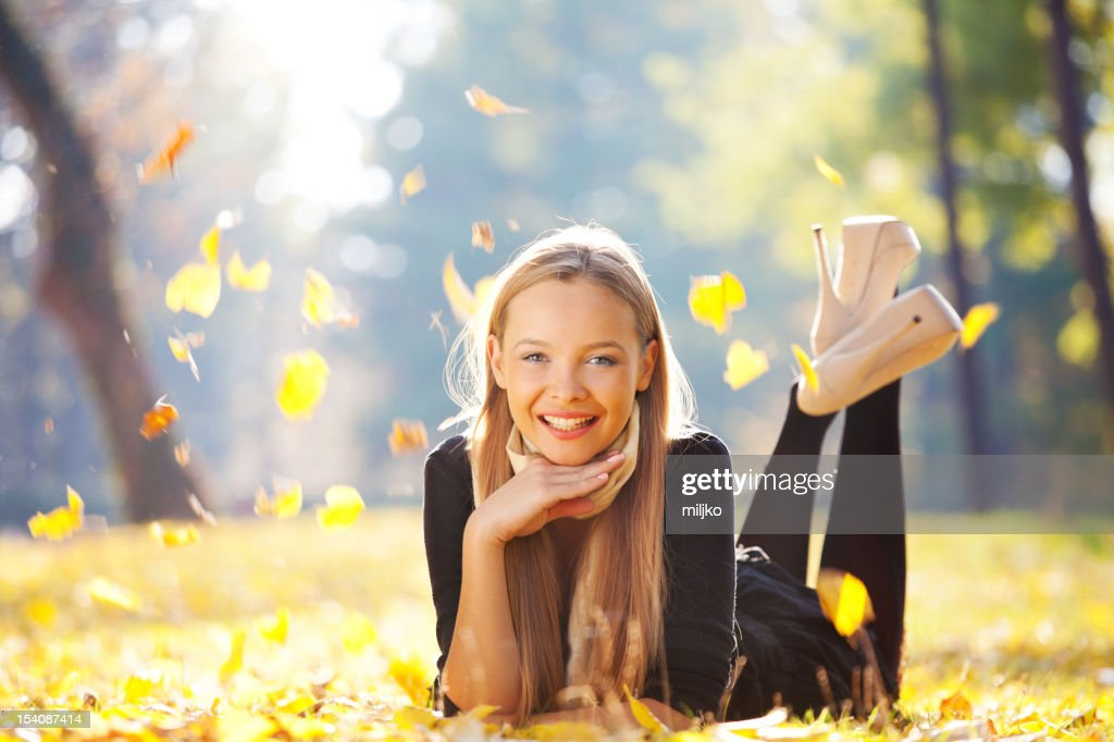 Fashion girl enjoying in the park : Stock Photo