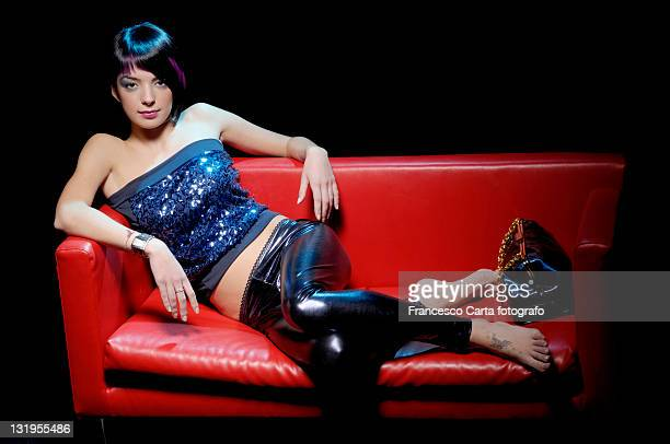 Fashion girl laying on sofa