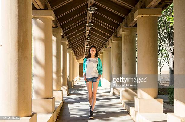 fashion girl walk in the corridor