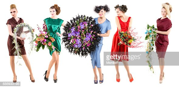 Fashion girls presenting bunches of flowers : Stock Photo