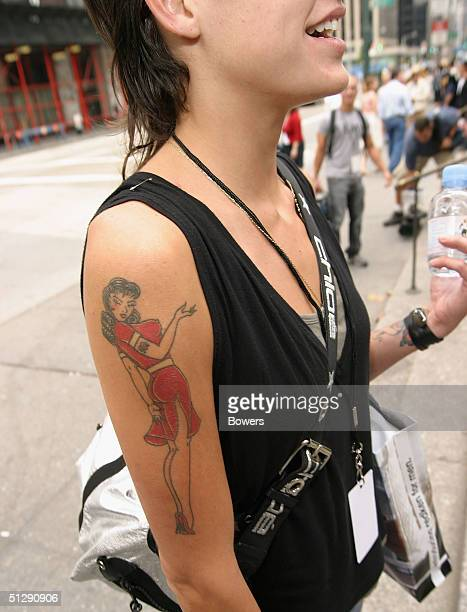 A fashion goer shows off a Bettie Page tattoo during the Olympus Fashion Week Spring 2005 at Bryant Park September 11 2004 in New York City