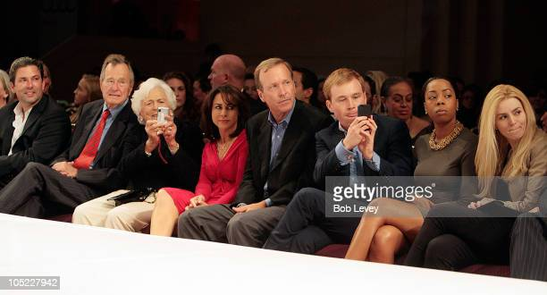 Fashion Houston President Jared Lang sits with Former President George HW Bush along with wife Barbara Bush their son Neil Bush and his wife Maria...