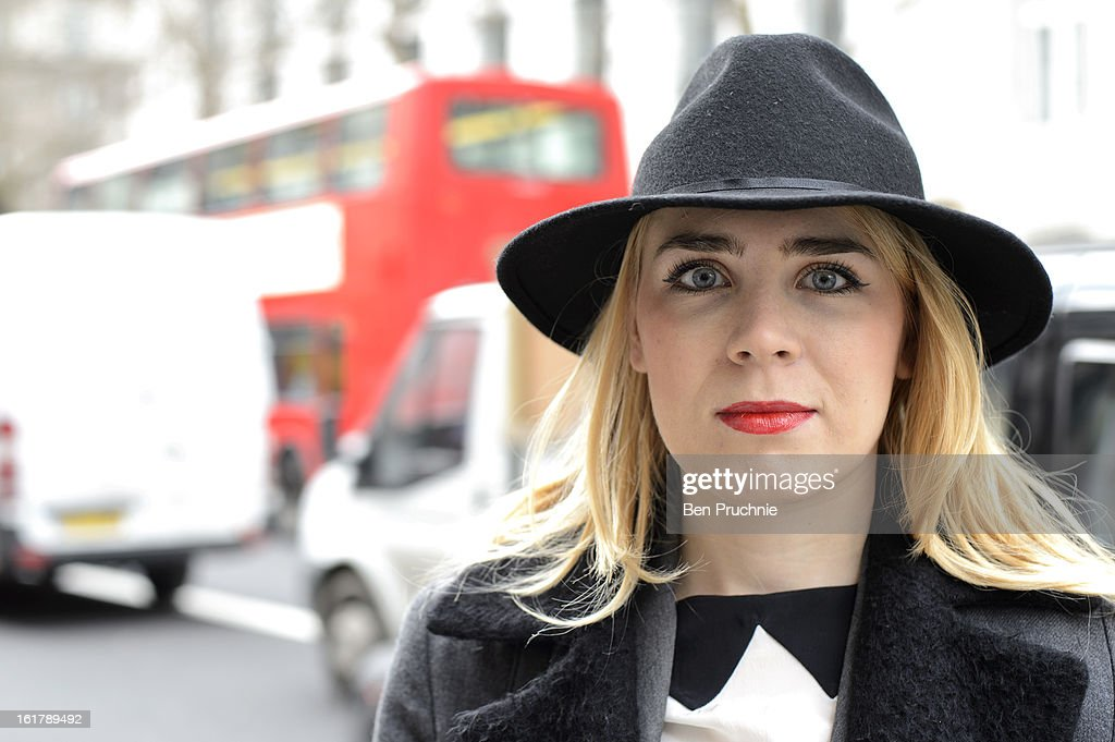 Fashion Illustrator Adriana (23) poses wearing a Topshop hat, Simple coast, French Connection trousers Zara shirt and unbranded Italian shoes at Somerset House during London Fashion Week F/W 2013 on February 16, 2013 in London, England.