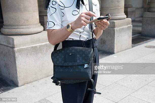 Fashion Influencer Filippo Fiora wears a Louis Vuitton shirt and bag and Caruso trousers on day 2 of Paris Collections Men on June 23 2016 in Paris...