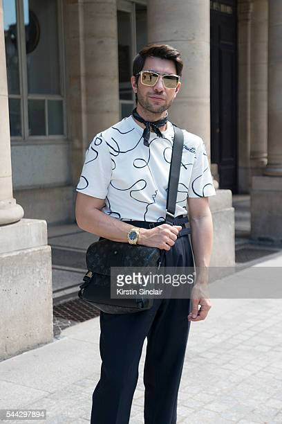 Fashion Influencer Filippo Fiora wears Louis Vuitton shirt and bag and Caruso trousers on day 2 of Paris Collections Men on June 23 2016 in Paris...