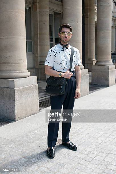 Fashion Influencer Filippo Fiora wears Louis Vuitton shirt and bag Caruso trousers and Edhen shoes on day 2 of Paris Collections Men on June 23 2016...