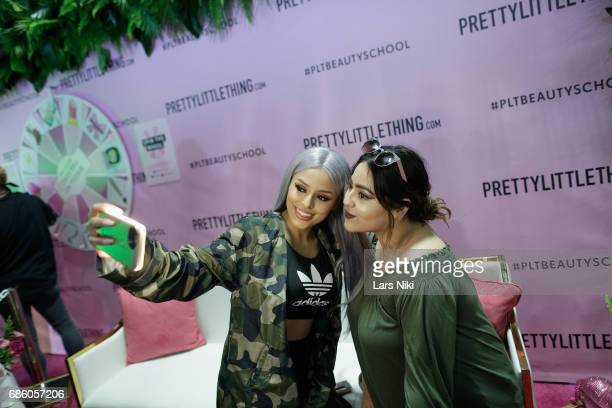 Fashion Influencer Isabel Bedoya takes a selfie with a guest during Beautycon Festival NYC 2017 at Brooklyn Cruise Terminal on May 20 2017 in New...