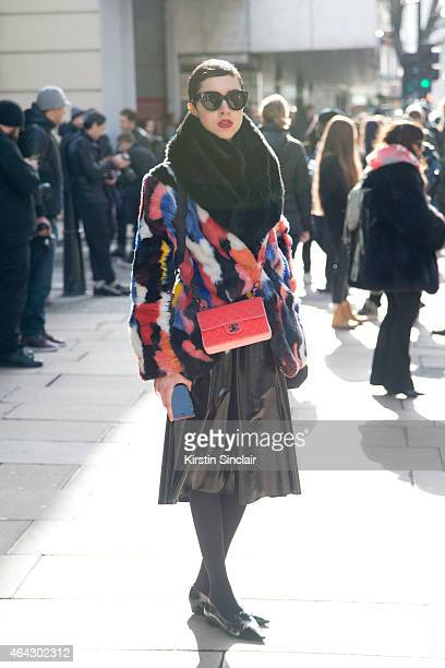 Fashion journalism student Maddy Killick wears a Story of Lola Coat Chanel bag Topshop skirt Red or Dead shoes Zara scarf and Celine Sunglasses on...