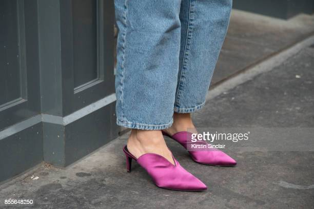 Fashion journalist and co founder of wwwandfinallycouk Anna Rosa Vitiello wears Current Elliot jeans and Aeyde shoes on day 2 of London Womens...