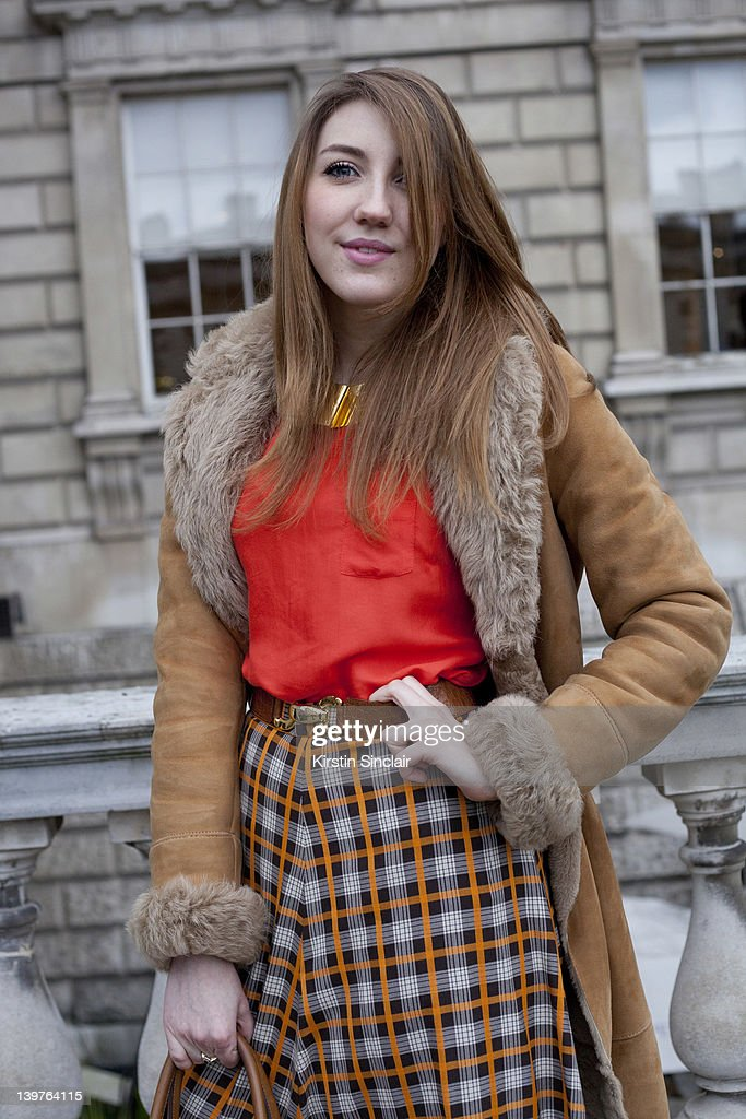 KINGDOM - FEBRUARY 21 Fashion journalist Annabella Smith wearing a Vintage skirt, new Look top, Mulberry vintage belt, Zara jacket and a Jaeger necklace street style at London fashion week autumn/winter 2012 womenswear shows on February 21, 2012 in London, England.