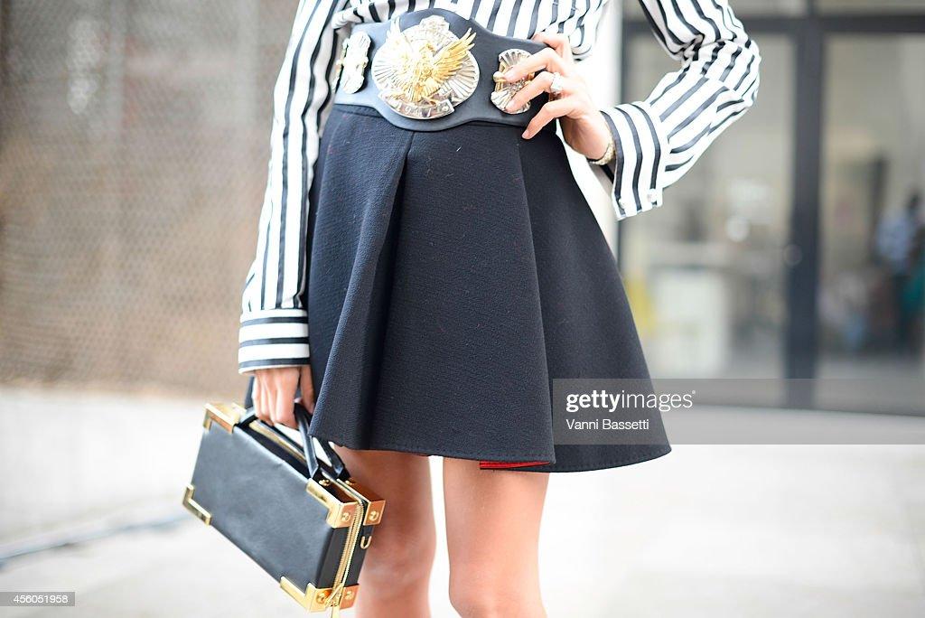 Fashion journalist Erica Pelosini wears a Balmain shirt Emilio Pucci belt Fausto Puglisi skirt and Sebastian bag on September 24 2014 in Paris France