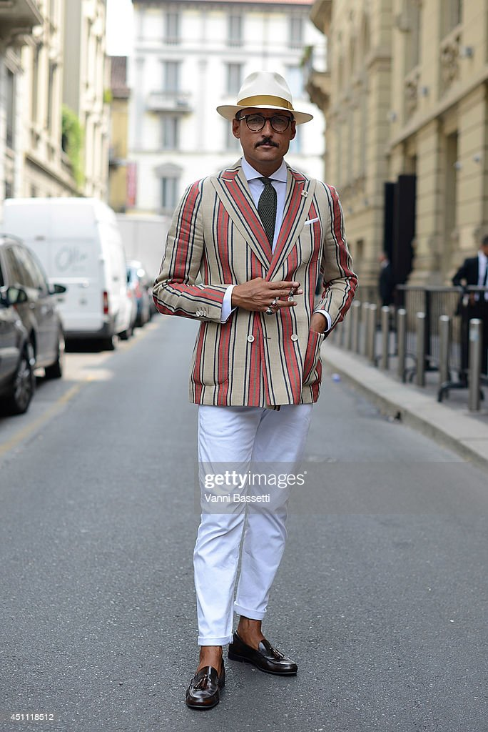 Fashion journalist Fabrizio Oriani is seen wearing a Lardini jacket and Zara shoes after Gucci show on June 23, 2014 in Milan, Italy.