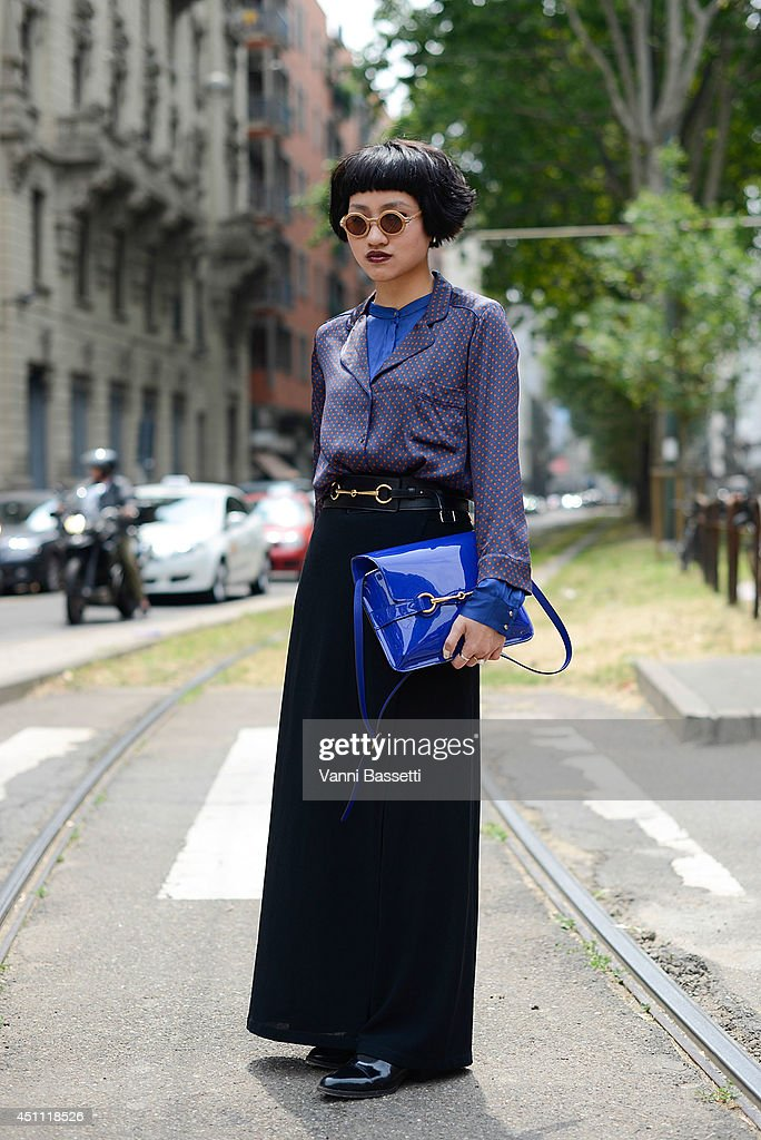 Fashion Journalist Fame Ornruja Boonyasit is seen wearing an Armani shirt, Ralph Laurent pants, Gucci bag and belt and Waiting for the sun sunglasses before Gucci show on June 23, 2014 in Milan, Italy.