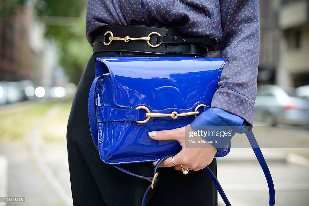 Fashion Journalist Fame Ornruja Boonyasit is seen wearing an Armani shirt, Ralph Laurent pants, Gucci bag and belt before Gucci show on June 23, 2014 in Milan, Italy.