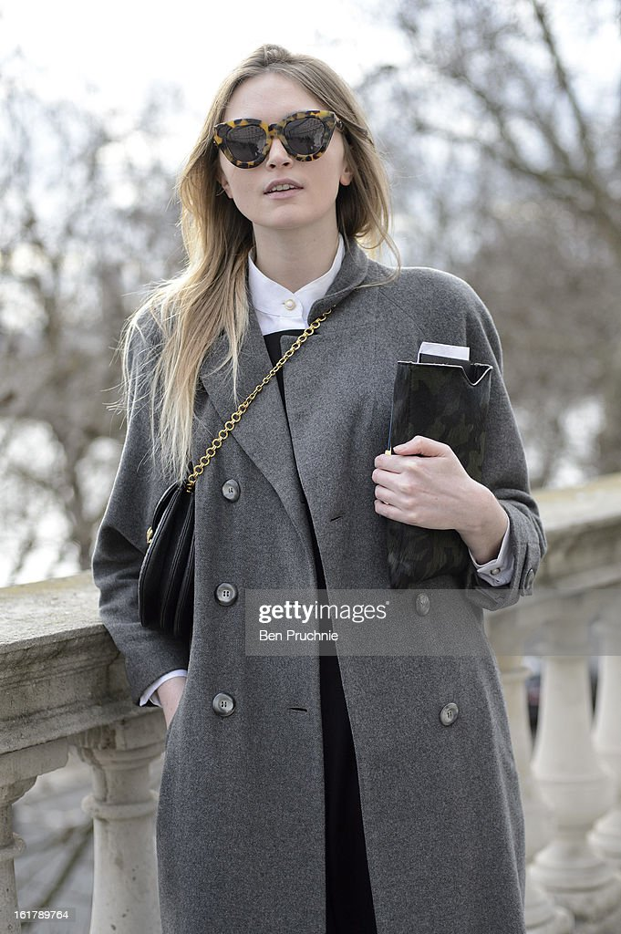 Fashion journalist Jane (25) poses wearing a Topshop jumpsuit, Marks and Spencer shirt, Vintage coat and bag with Hudson shoes at Somerset House during London Fashion Week F/W 2013 on February 16, 2013 in London, England.