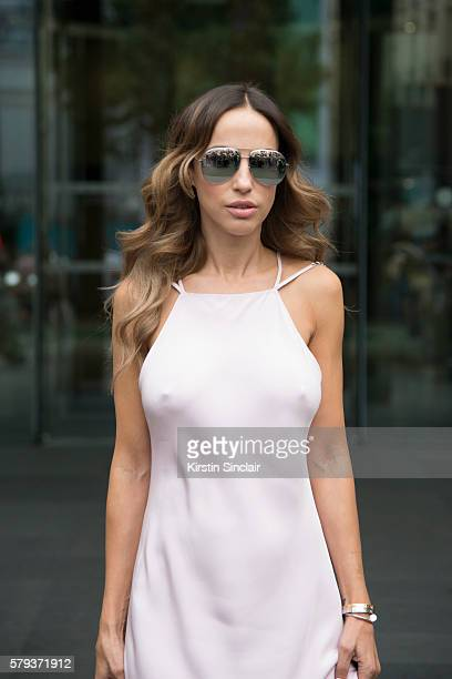 Fashion journalist Milana Koroleva wears an Isetta dress and Dior sunglasses day 4 of Paris Haute Couture Fashion Week Autumn/Winter 2016 on July 6...