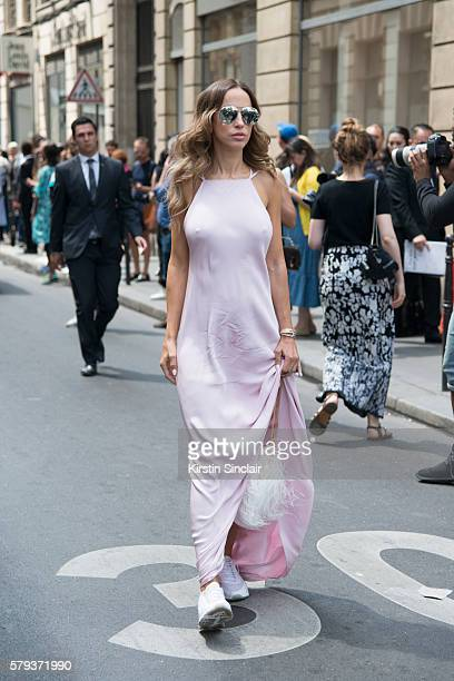 Fashion journalist Milana Koroleva wears an Isetta dress Elie Saab bag Dior sunglasses and Nike sneakers day 4 of Paris Haute Couture Fashion Week...