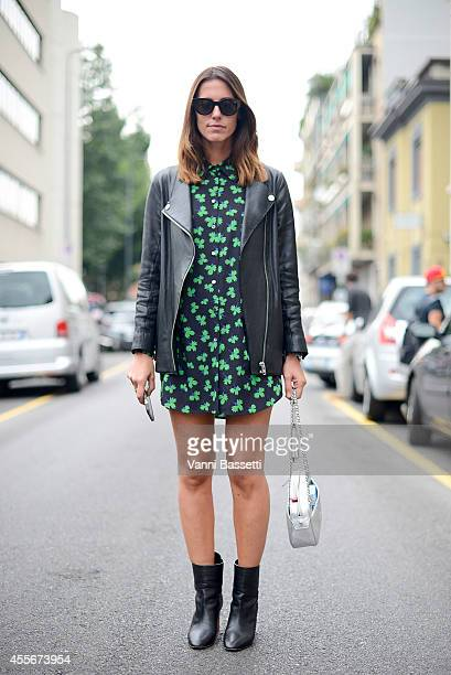 Fashion journalist Rita Benedetto poses wearing an Acne jacket Parosh dress Tori Burch bag and Choies shoes on September 18 2014 in Milan Italy