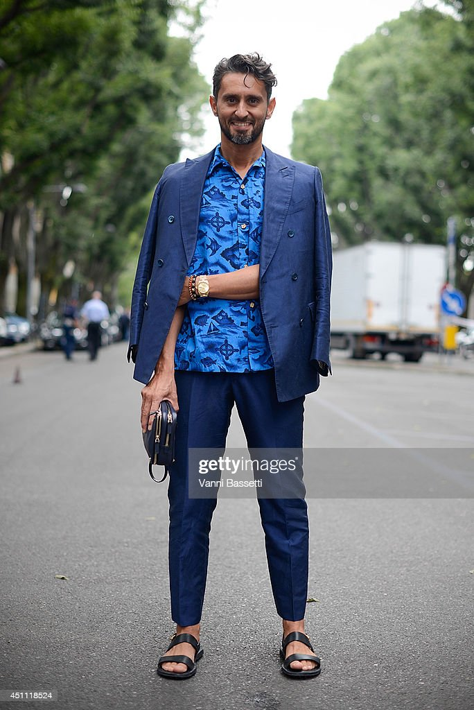 Fashion journalist Simone Marchetti poses in a Ports 1961 suit and a vintage shirt before Emporio Armani show on June 23, 2014 in Milan, Italy.