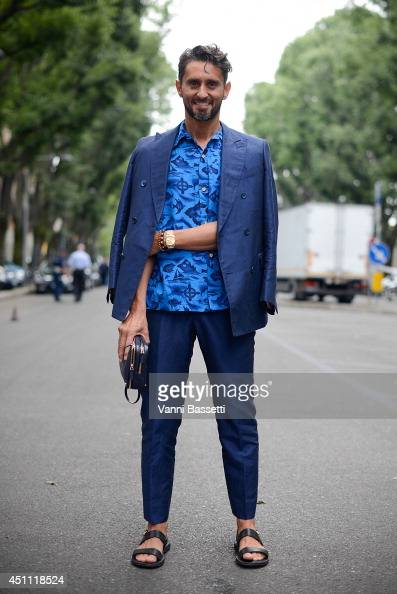 Fashion journalist Simone Marchetti poses in a Ports 1961 suit and a vintage shirt before Emporio Armani show on June 23 2014 in Milan Italy
