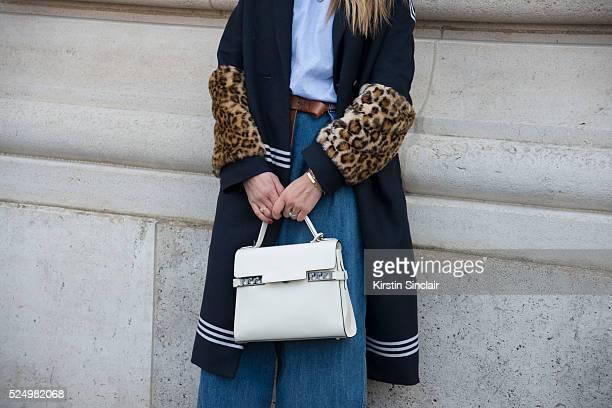 Fashion Journalist Tiany Kiriloff wears a Baum und Pferdgarden jacket Dries Van Noten jeans Delvaux bag on day 7 during Paris Fashion Week...