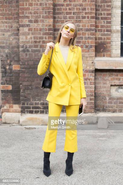 Fashion Lawyer Violet Atkinson is wearing a Topshop suit Isabelle Quinn glasses Chanel bag and Tony Bianco boots during MercedesBenz Fashion Week...