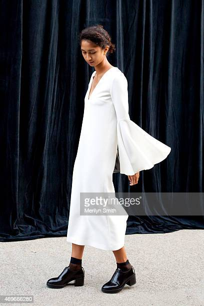 Fashion Manager Elizabeth McPherson wears an Ellery dress Acne shoes and vintage bag at MercedesBenz Fashion Week Australia 2015 at Carriageworks on...