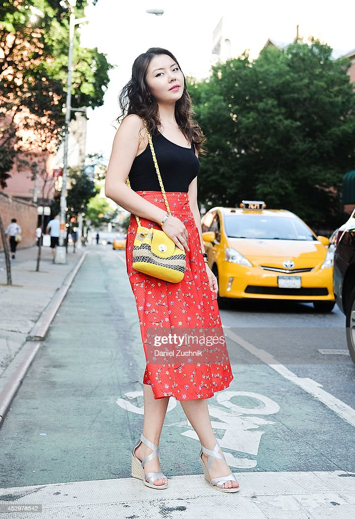 Fashion Merchandiser Ninel is seen around Nolita wearing a Uniqlo top, Italian made dress, Ralph Lauren shoes and vintage Italian bag on July 31, 2014 in New York City.