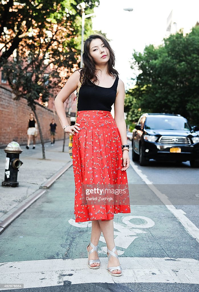 Fashion Merchandiser Ninel is seen around Nolita wearing a Uniqlo top, Italian made dress and Ralph Lauren shoes on July 31, 2014 in New York City.