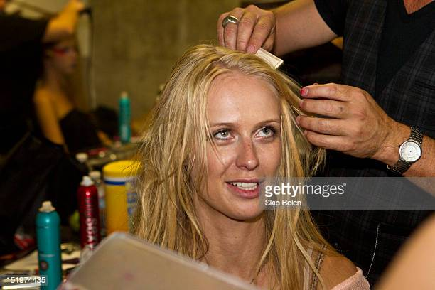 Fashion model and America's Next Top Model Cycle 7 winner CariDee English prepares backstage before the Indashio show during Spring 2013 MercedesBenz...