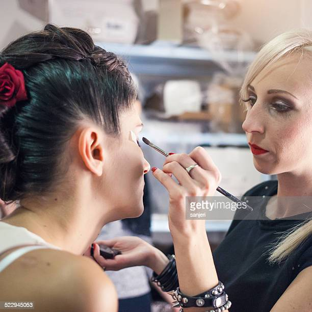 Fashion model and make up artist at the fashion show
