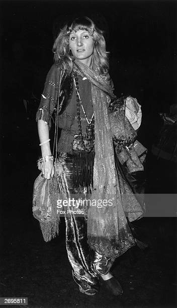 Fashion model Ann Rochon at Waterloo Station London on her way to the Isle of Wight Pop Festival in full hippy regalia She wears crushed velvet...
