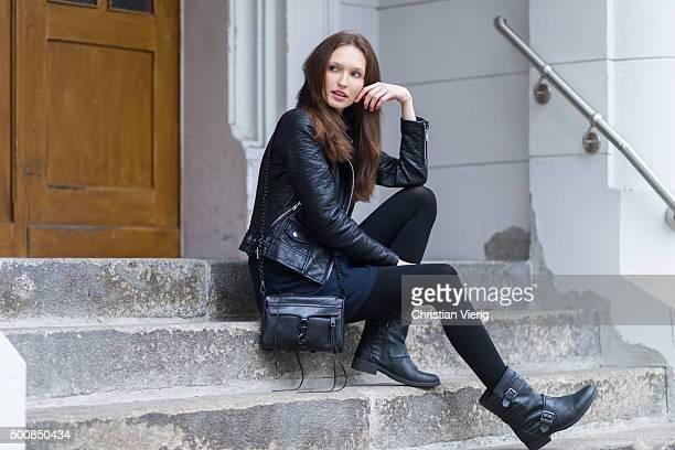 Fashion model Anna Wilken wearing Zara jacket dress Buffalo boots Rebecca Minkoff bag on December 10 2015 in Berlin Germany