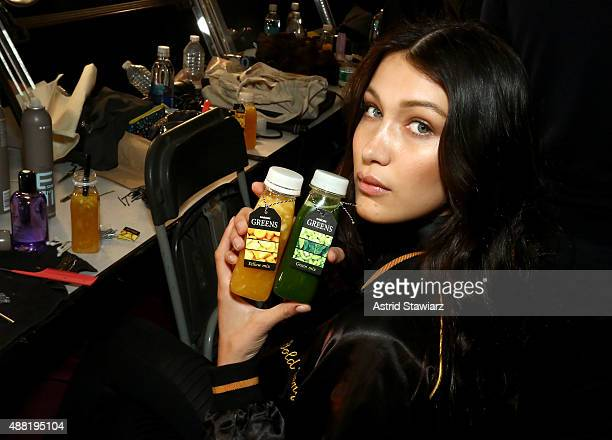 Fashion Model Bella Hadid prepares backstage with Kagome Greens At Jeremy Scott at Skylight at Moynihan Station on September 14 2015 in New York City