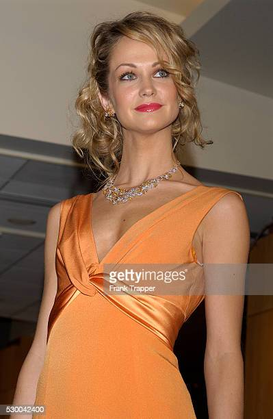 Fashion model Carrie wears a Kevan Hall tangerine twist front gown with Chopard tricolor diamonds floral set at the 77th Annual Academy Awards��...