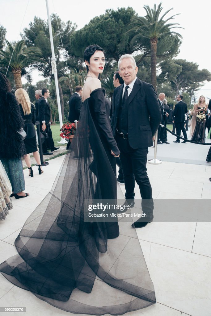 Fashion model Coco Rocha and designer Jean Paul Gaultier are photographed for Paris Match whilst attending the Amfar Gala at the Eden Roc Hotel on May 25, 2017 in Antibes, France.