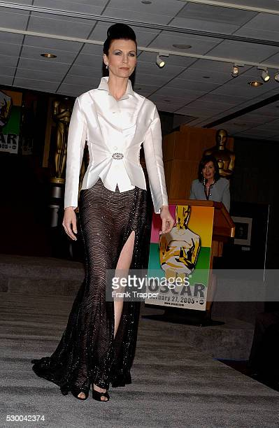 Fashion model Darienne wears a Kay Unger white shirt with black beaded skirt and Martin Katz vintage onyx and diamond brooch and cushion diamond drop...