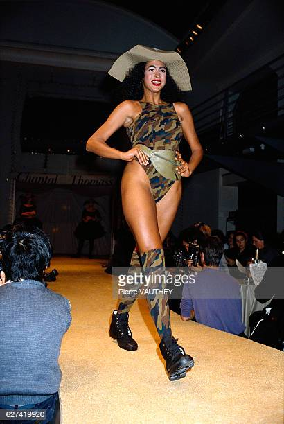 A fashion model dons the latest readytowear women's fashion line by design house Chantal Thomas at the 1988 SpringSummer fashion show in Paris She...