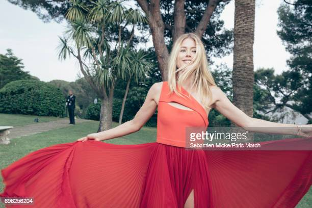 Fashion model Doutzen Kroes wearing a Hugo Boss dress is photographed for Paris Match whilst attending the Amfar Gala at the Eden Roc Hotel on May 25...