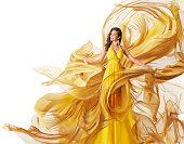 Fashion Model Dress, Woman in Flowing Fabric Gown, Clothes Flow on Wind, White Yellow