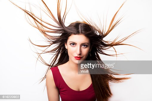 Fashion model girl portrait with long blowing hair. : Stock Photo