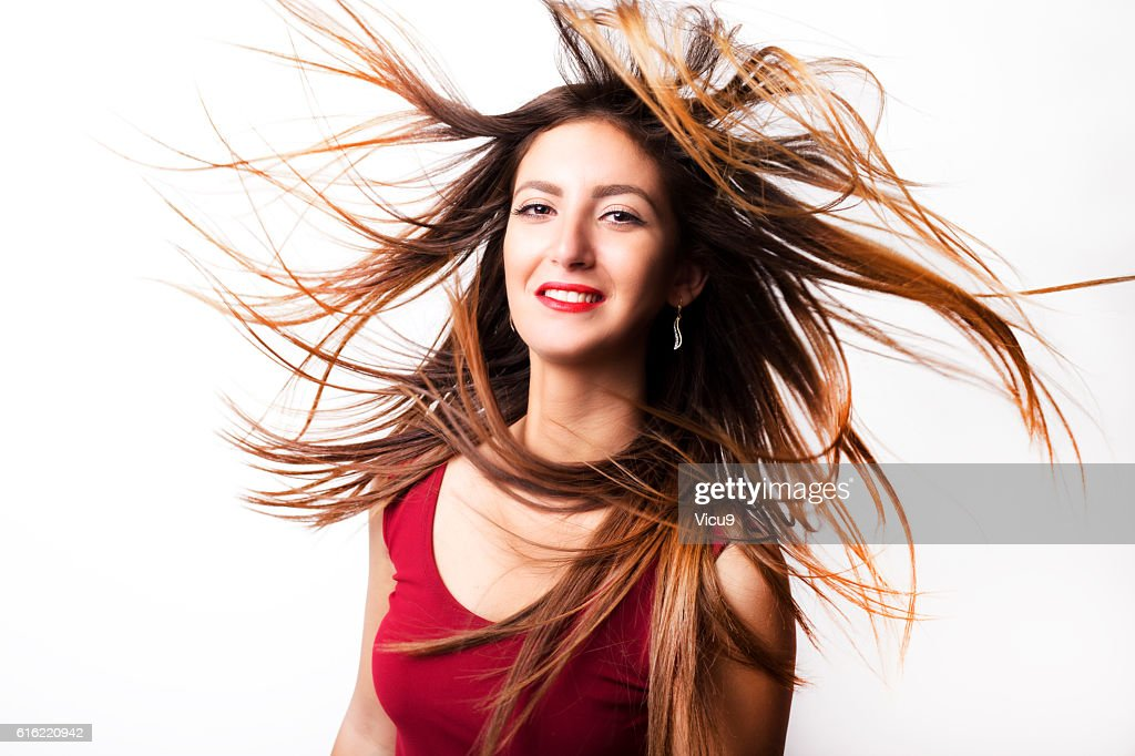 Fashion model girl portrait with long blowing hair. : ストックフォト