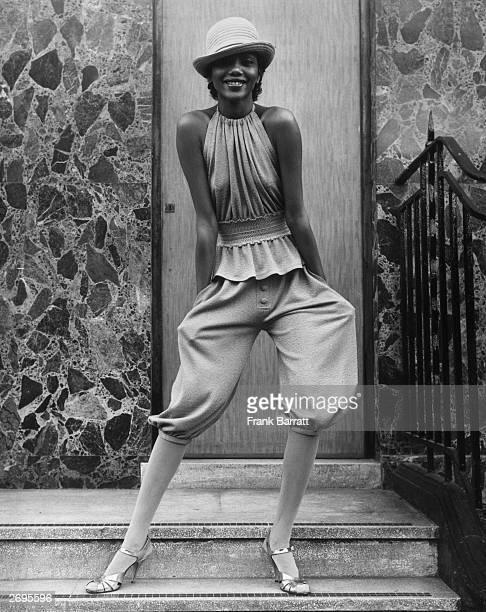 Fashion model Hazel wearing coffeecoloured knickerbockers and a peplum bib top designed by John Bates for Jean Varon