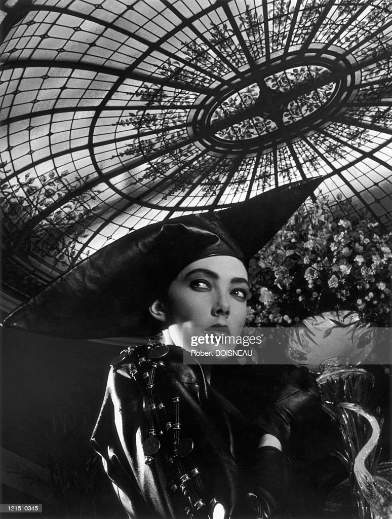 A Fashion Model In Black Leather, Under The Bofinger Glass-Roof, In Paris